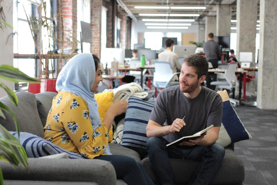 Zainab Baloch, a member operations specialist at fintech startup Even, speaks with CEO Jon Schlossberg at the company's Oakland headquarters.