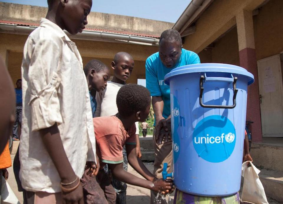 On 6 June 2018 at Ikenge School in Mbandaka in the Democratic Republic of the Congo, Leon Kalolo, a UNICEF Education Officer, instructs children how to properly wash their hands to prevent the spread of Ebola.