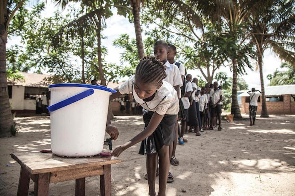 On 22 May 2018, children wash their hands to help contain the Ebola outbreak before entering a classroom in the north-western city of Mbandaka, in the Democratic Republic of the Congo.