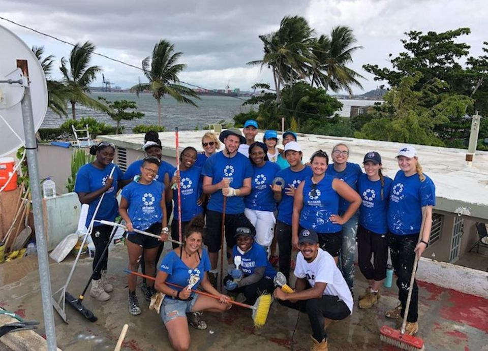 Student volunteers from State University of New York (SUNY) and City University of New York (CUNY) schools are spending the summer helping families in Puerto Rico rebuild homes damaged by Hurricane Maria.