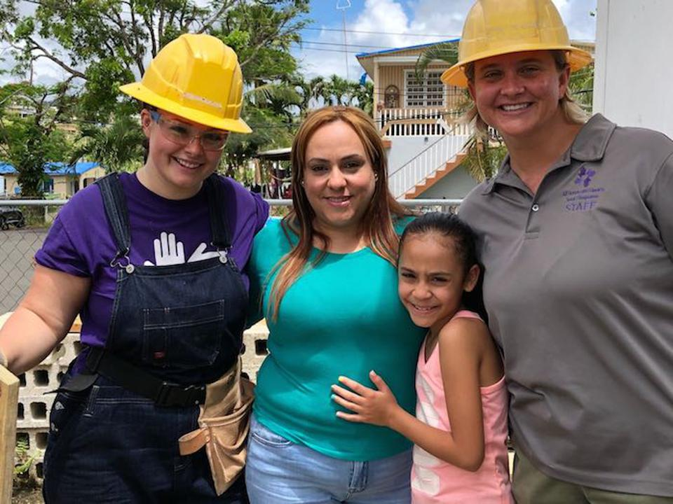 Nine-year-old Sofia and her mother were on site to see the volunteers' hard work come together. Soon, they'll have a new roof.