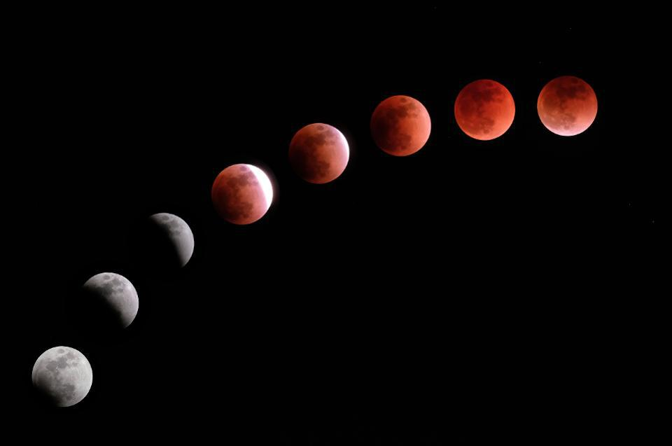 Time lapse of the Moon undergoing a total lunar eclipse at various stages.