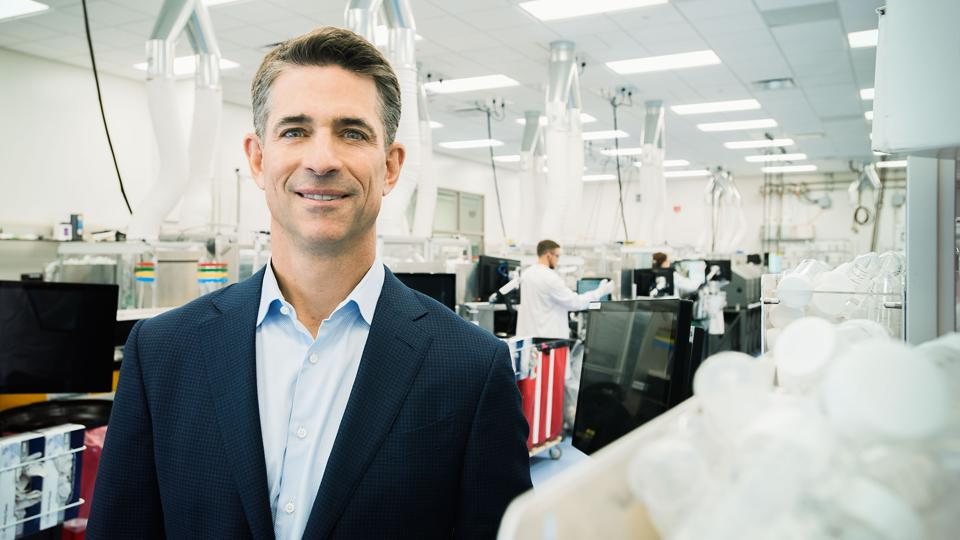 Chief executive Kevin Conroy stands in a specimen-processing area at Exact Sciences in Madison, Wisconsin. Exact is building a second facility that could process 4.5 million colon cancer screening tests a year.
