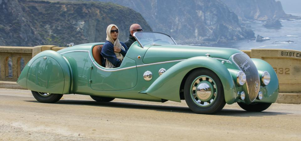 Two for the Road: A 1938 Peugeot 402 Darl'mat Legere 'Special Sport' Roadster along the Tour d'Elegance course (Copyright © Kimball Studios / Courtesy of Pebble Beach Concours d'Elegance)