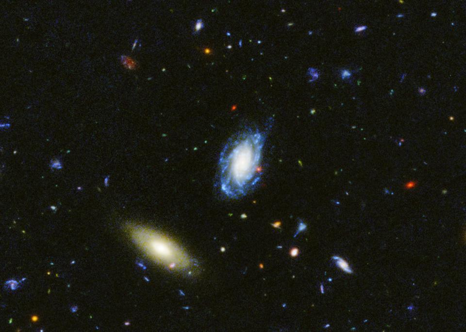 Two nearby galaxies as seen in the ultraviolet view of the GOODS-South field.