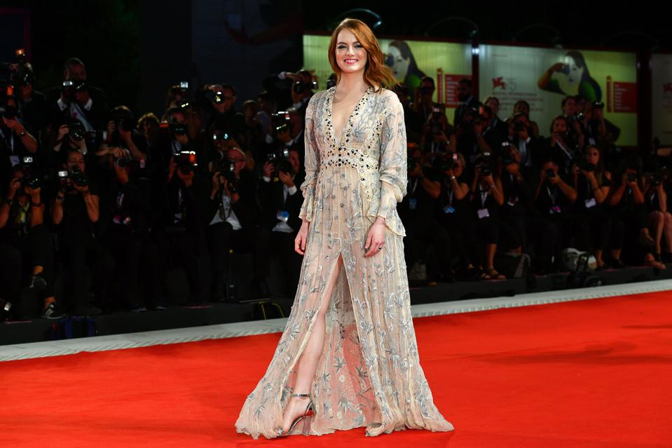 Oscar Favorite: Emma Stone (in a sheer Louis Vuitton gown) at the premiere of her film 'The Favourite' at Venice.