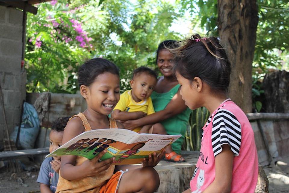 For these sisters in Timor-Leste, reading is a family affair.