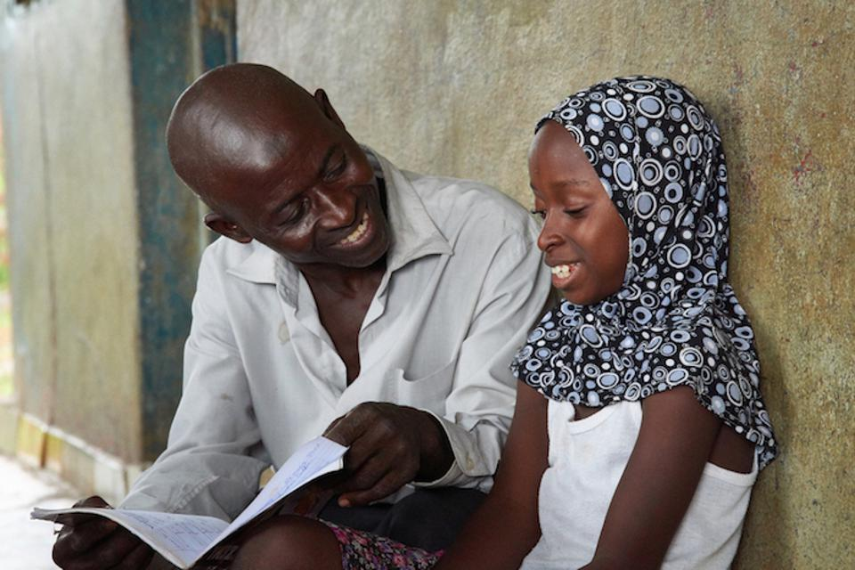 Sulaiman Samura never learned to read. Growing up in Sierra Leone, the 55-year-old gardener didn't have the chance to go to school, but he's determined that his nine children have better opportunities in life.