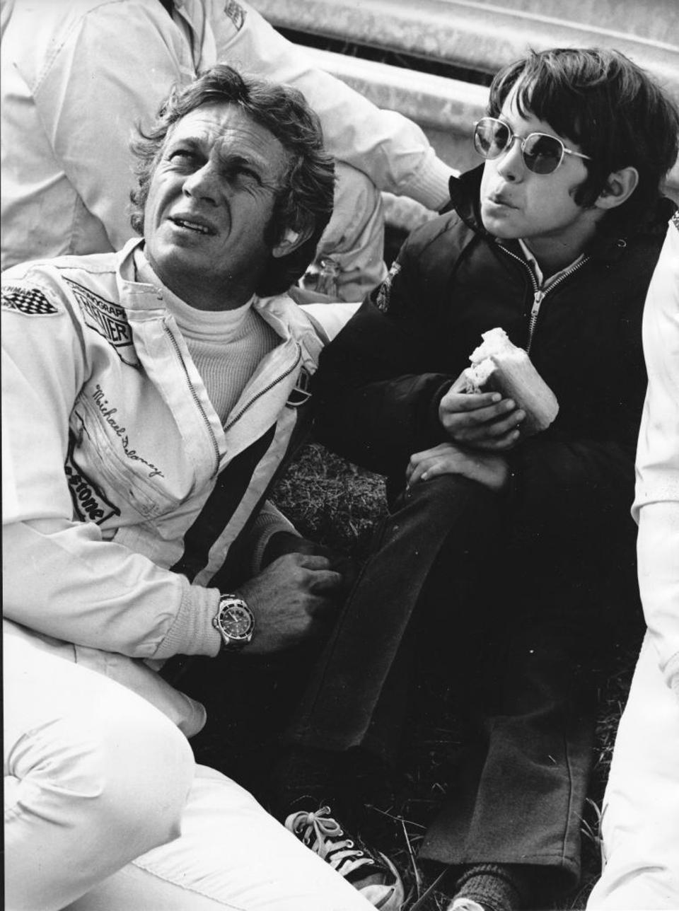 Father and son: McQueen, with his son, Chad, relaxes on the set of the 1971 movie 'Le Mans.' Though he wore a Heuer Monaco in the movie, he sports a Rolex Submariner here.