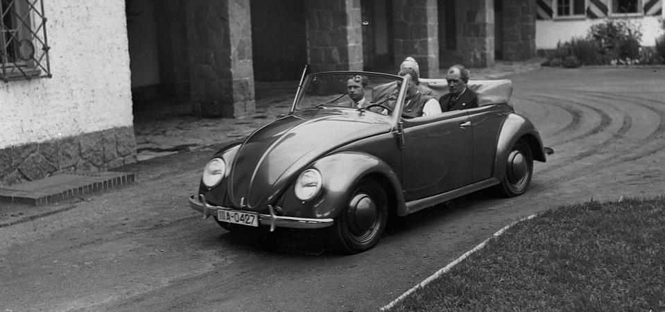 A 1939 Volkswagen Type 1 convertible, with Ferdinand Porsche in the back seat.