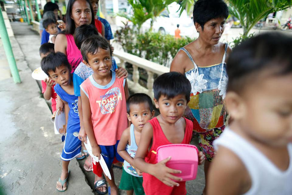 Children wait to get food at the school turned evacuation center in Ilocos Norte Province, Luzon on September 14, 2018.