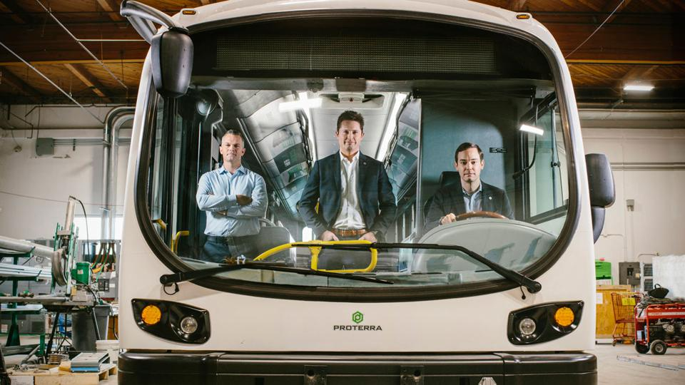 Proterra COO Josh Ensign, left, battery expert Dustin Grace, center, and CEO Ryan Popple at Proterra headquarters in Burlingame, California. All three are former Tesla employees.