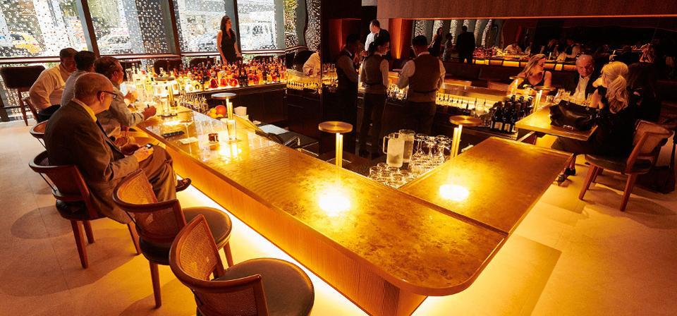 Seasons Greeting: A gold-flecked sunken bar (which evokes the original Pool Room designed by Philip Johnson) welcomes diners upon entering the new restaurant. The bar area can accommodate 50 and features a light menu.