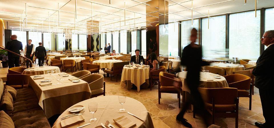Big City, Bright Lights: Designed by Brazilian architect Isay Weinfeld, the dining room features 33 tables with many Modernist elements and tableware reminiscent of the original Four Seasons.