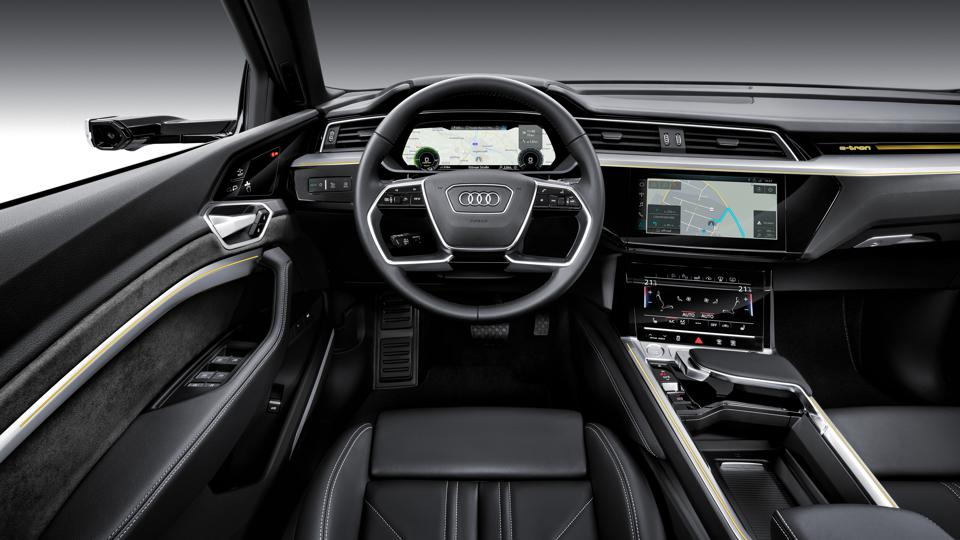 Virtual side-view cameras will replace side-view mirrors everywhere but the U.S. The system will use small exterior side cameras whose images are displayed on 7-inch OLED screens in the dash.