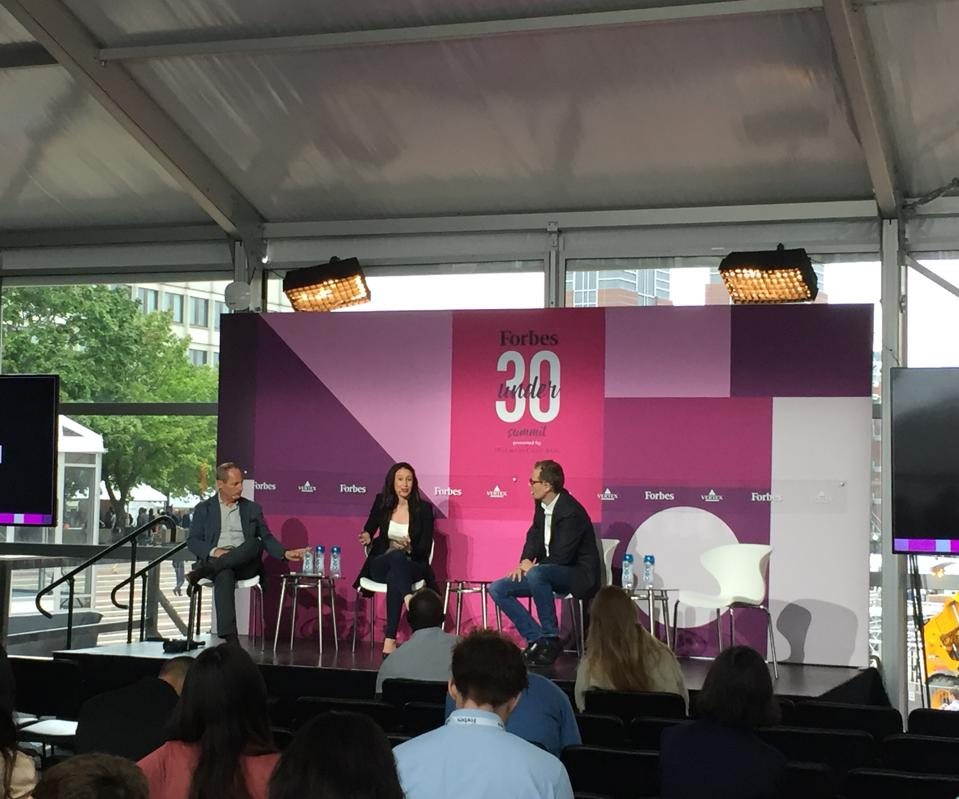 Flagship Pioneering's Doug Cole (left) and 30 Under 30 alum Cigall Kadoch (middle) appear at the Under 30 Summit on October 1 in Boston.