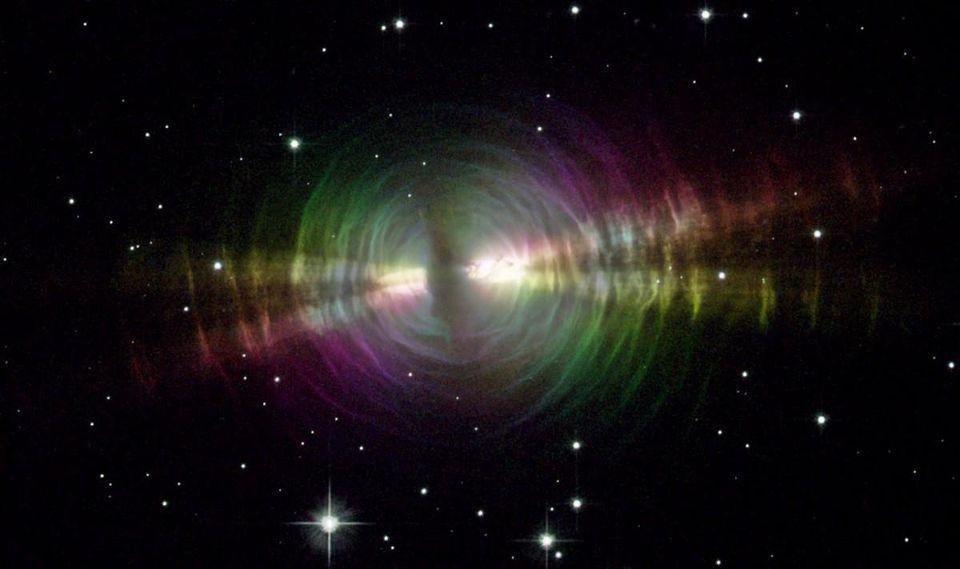 Hubble image of the Egg Nebula, a protoplanetary nebula around a dying, evolved star.