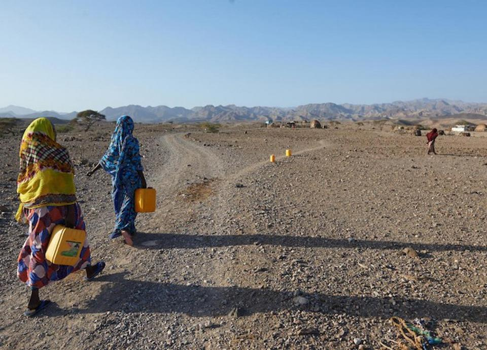 After collecting safe drinking water from a UNICEF-supported water point, women walk home in the village of Dafo in southern Djibouti.