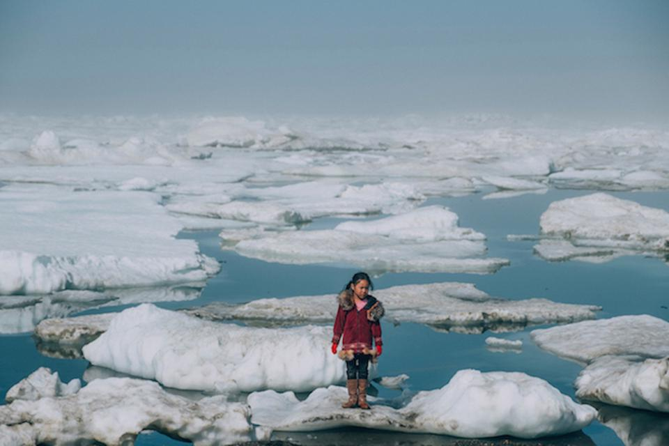 An Iñupiat girl Amaia, 11, standing on an ice floe in the Arctic Ocean in Barrow, Alaska. The anomalous melting of the Arctic ice is one of the many effects of global warming that has a serious impact on the lives of humans and wildlife.