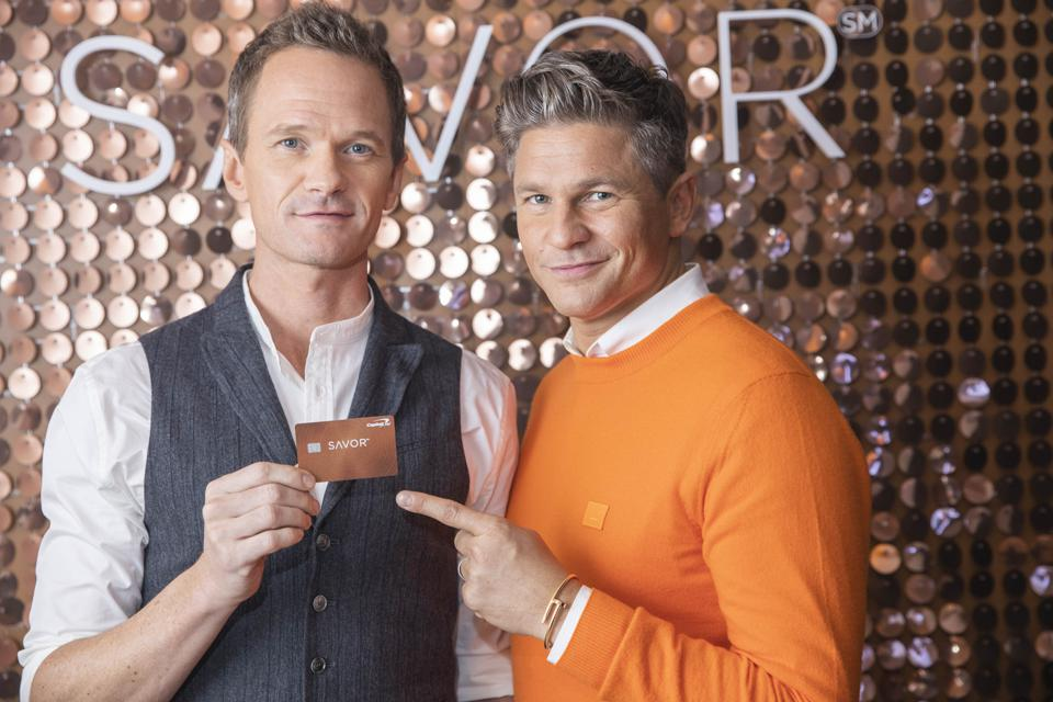 Neil Patrick Harris and David Burtka are ambassadors for the new Capital One Savor card, which offers 4% cash back on dining and entertaining.