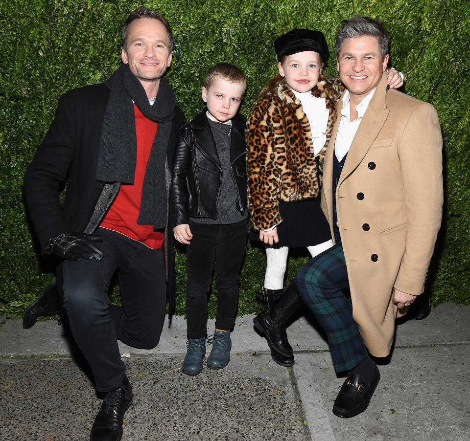 The Burtka-Harris family attends the Saks Fifth Avenue and Disney 'Once Upon A Holiday' windows unveiling in 2017.
