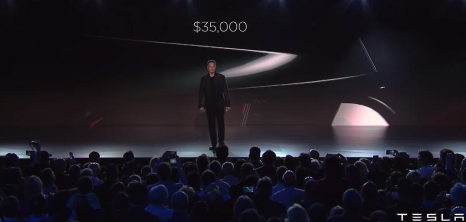 Elon Musk touts the $35,000 base price for Model 3 at the car's debut in March 2016. That version may finally be available in March 2019.