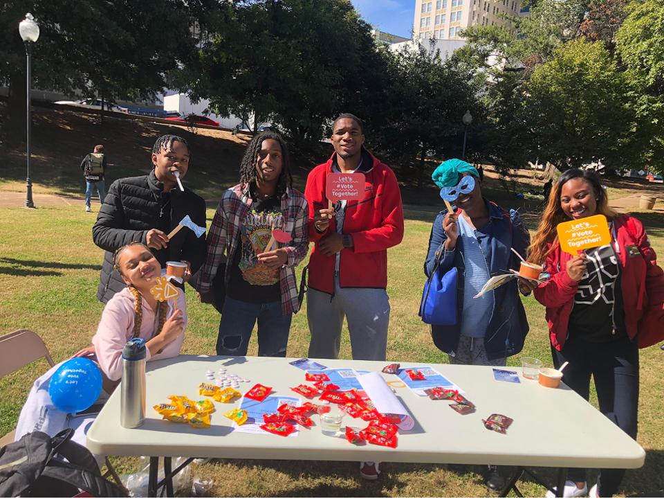 Georgia State students celebrating early voting at a #VoteTogether carnival on campus.