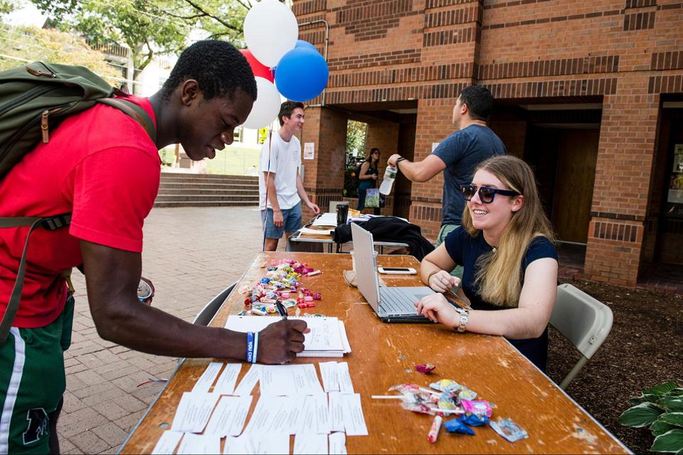 Students at Tufts University register to vote and sign up with civic engagement and service organizations at an annual Civics Fest event on campus.