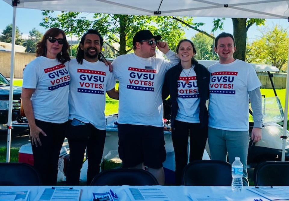 Members of the GVSU Campus Democratic Engagement Coalition registered students to vote at a football game tailgate.