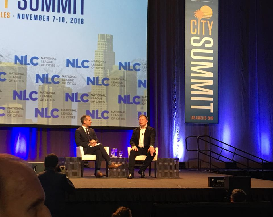 Los Angeles Mayor Eric Garcetti, left, and Elon Musk discuss progress with Musk's Boring Co. at the National League of Cities conference in Los Angeles on Nov. 8, 2018.