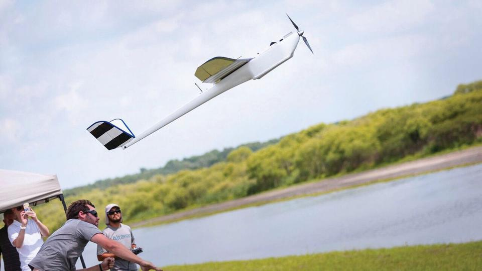 Altavian drone operators hand-launch one of their Nova unmanned aerial vehicles for a data-collecting mission.