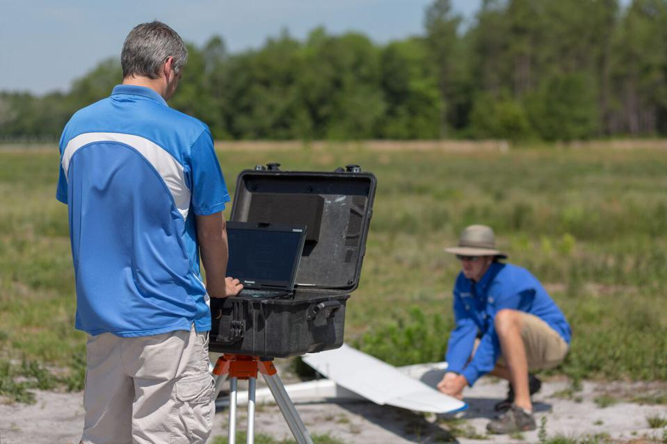 Altavian drone operators prepare to launch one of their Nova unmanned aerial vehicles on a data-collecting mission in Florida.