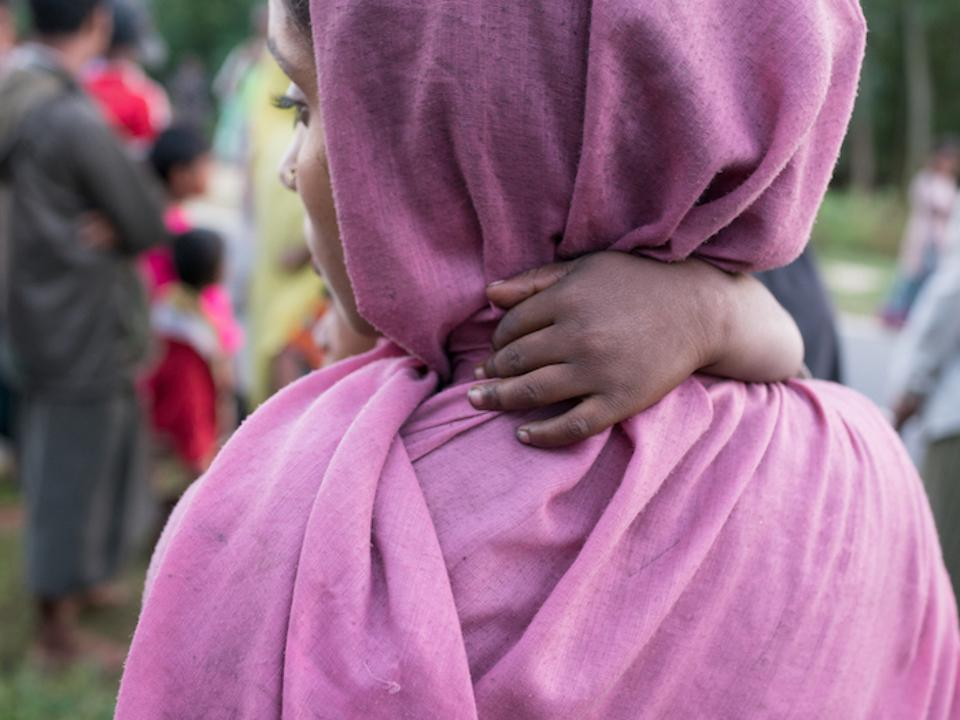 A Rohingya refugee mother and child on the shores of Bangladesh after crossing by boat from Myanmar, in Cox's Bazar district, Bangladesh, November 2017.