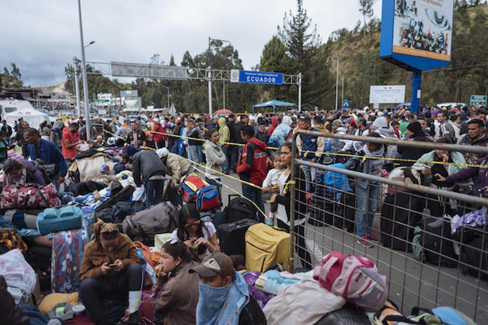 Hundreds of Venezuelans wait in Rumichaca at the border between Ecuador and Colombia in August 2018. Sleeping in the street, they waited up to four days to seal their passports so they could continue their journey.