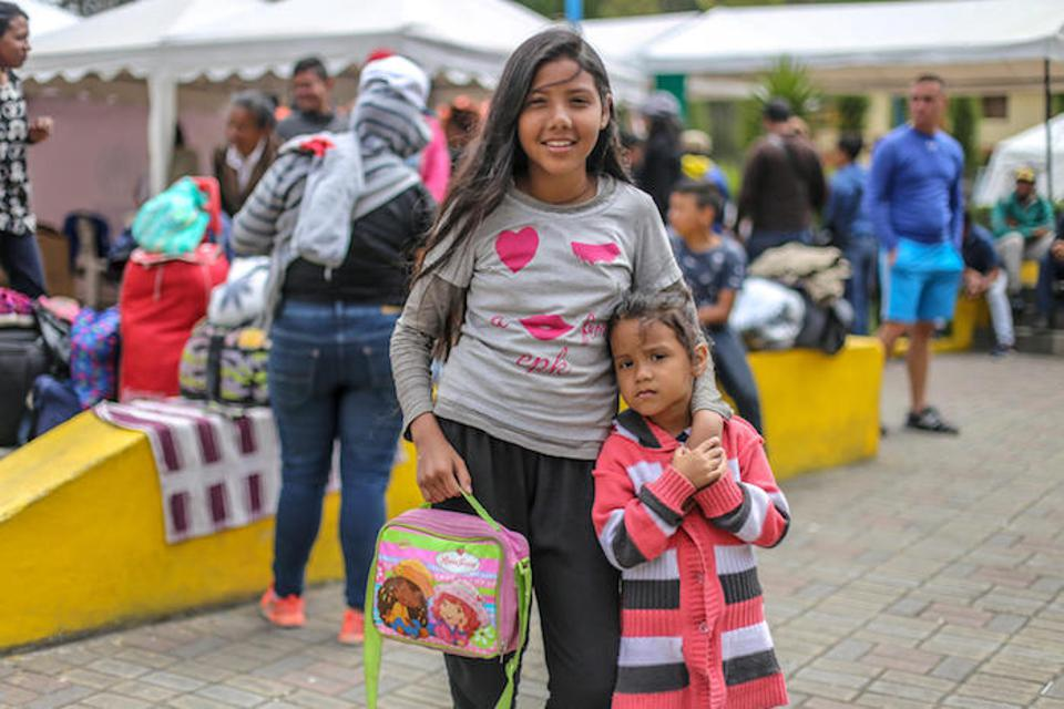 Alegna, 12, and her 4-year-old sister, Aignara, migrated with their family from Venezuela. On October 31, 2018, they waited in Rumichaca on the Ecuadorian side of the border with Colombia.