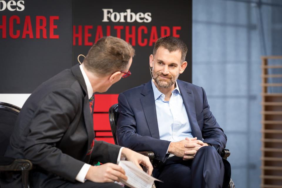 Billionaire John Arnold being interviewed by Matthew Herper at the 2018 Forbes Healthcare Summit.