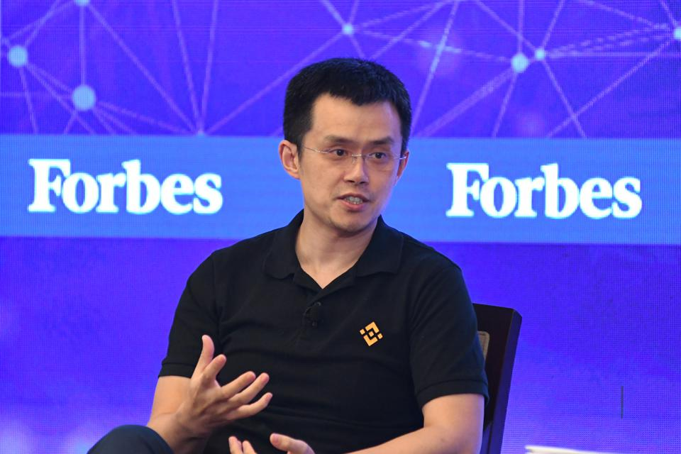 Binance CEO Zhao Changpeng addresses a room filled with Asian family investors.