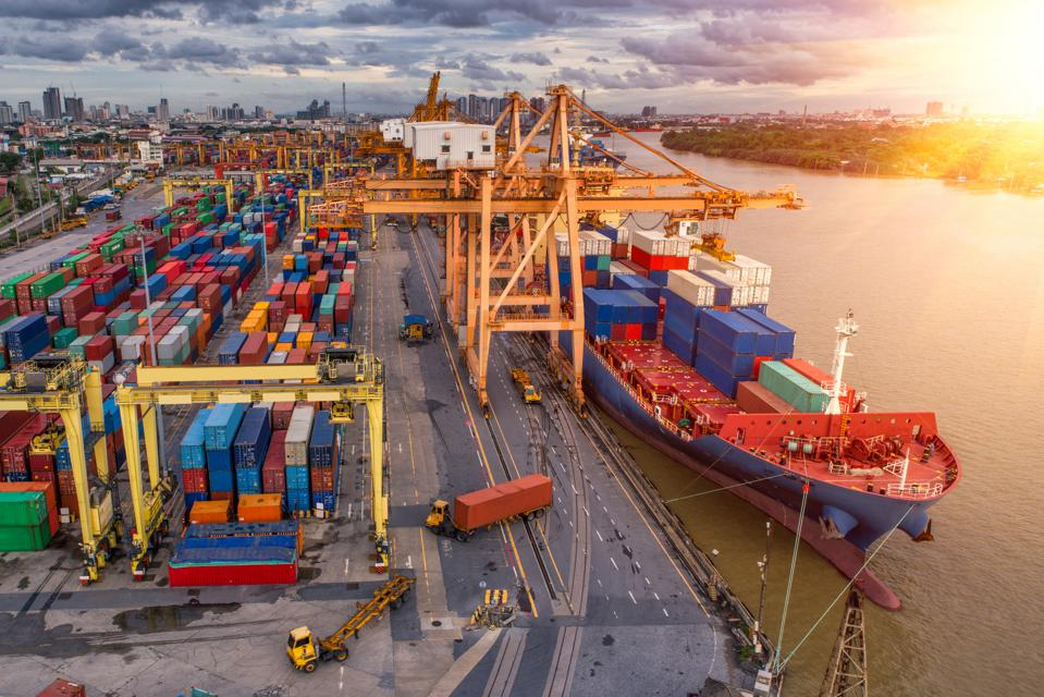 Tariffs meet global trade at a busy container port.