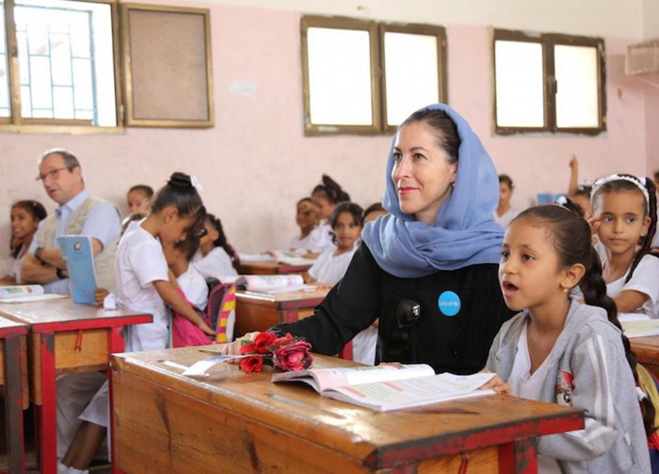 On 4 December 2018 at the Ibn Zaidoon School in Aden, Yemen, girls attend class with UNICEF Representative in Yemen Merixell Relano (center) and UNICEF Regional Director for Middle East and North Africa Geert Cappelaere (far left).
