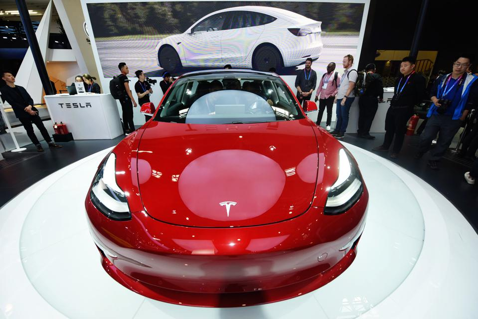 A Tesla Model 3 on display during Auto China 2018 at the China International Exhibition Center on April 25, 2018 in Beijing.