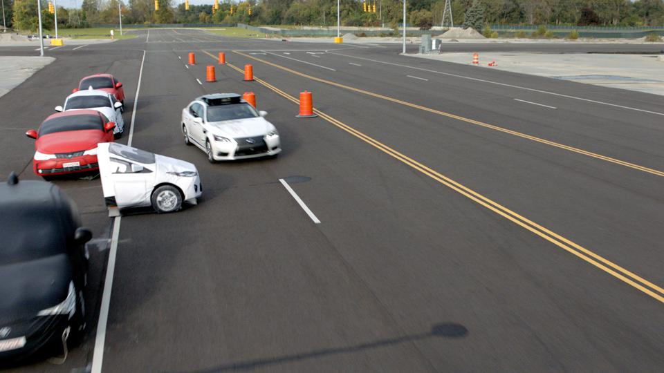 A Toyota test vehicle using Guardian swerves to avoid a potential crash at the company's Michigan test facility.