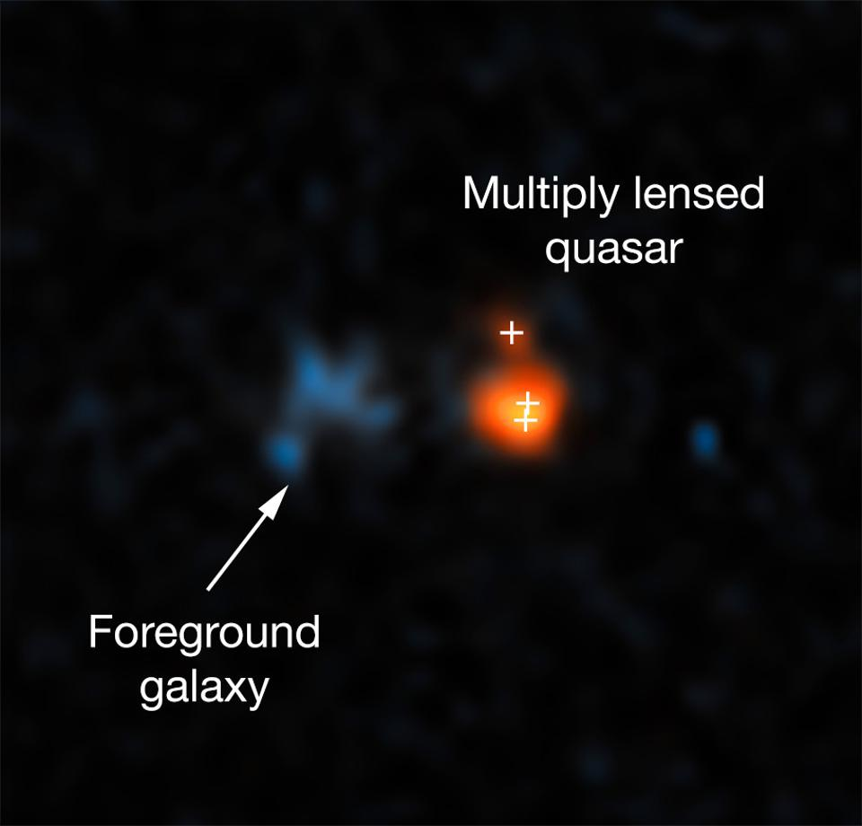This image shows the distant quasar J043947.08+163415.7 as observed with Hubble.