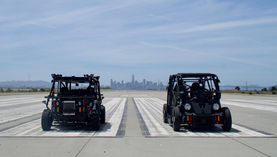 Zoox prototype vehicles VH4 and VH5 at a San Francisco Bay area test site.