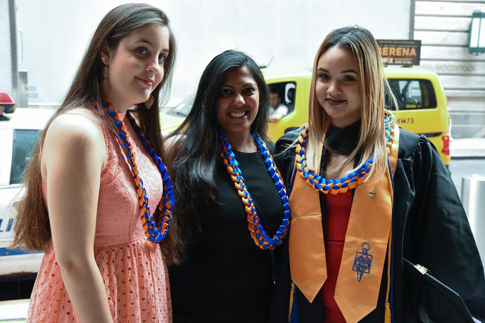 Guttman Community College graduates Gabby Rosario (L) and Miguelissa Martinez (R) stand with Deputy to Dean of Student Engagement Bindi Patel, who played a significant role in growing the mentorship program.