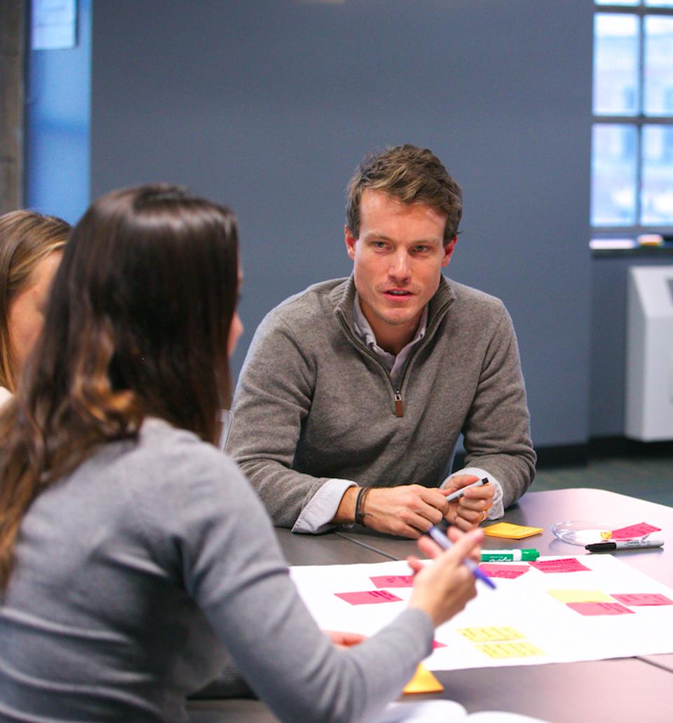 Professor Joesph Heritage works with students in the Design Studio