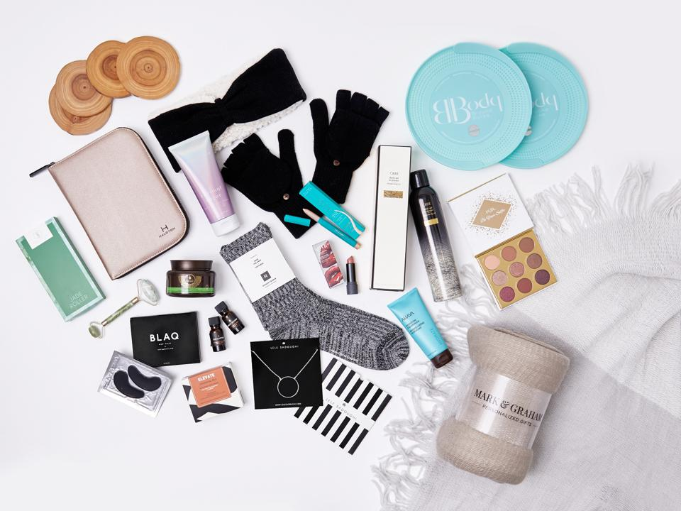 Coasters, blankets, comfy socks and makeup are some of the items inside FabFitFun's winter box.