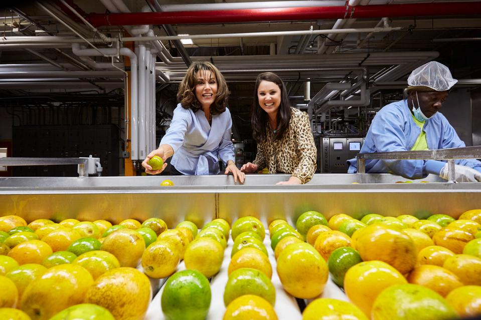 Marygrace and Natalie Sexton check an incoming shipment for bruises. Sexton's in-house juice plant is a rarity in an industry otherwise dominated by contract manufacturing.