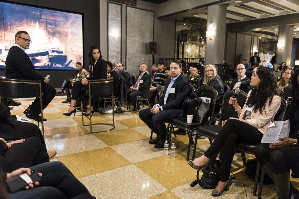 Doug Melville interviewt Iman Oubou, oprichter en hoofdredacteur van Swaay Media voor de Disruptor Series op de Forbes Content Marketing Summit in New York City.