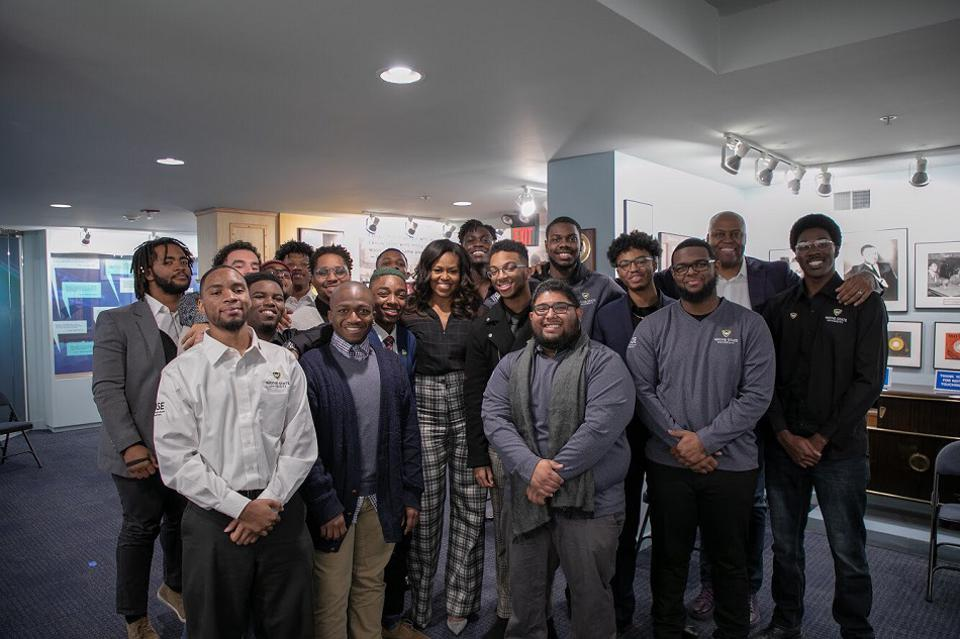 Jaquan with Michelle Obama, Craig Robinson, and group