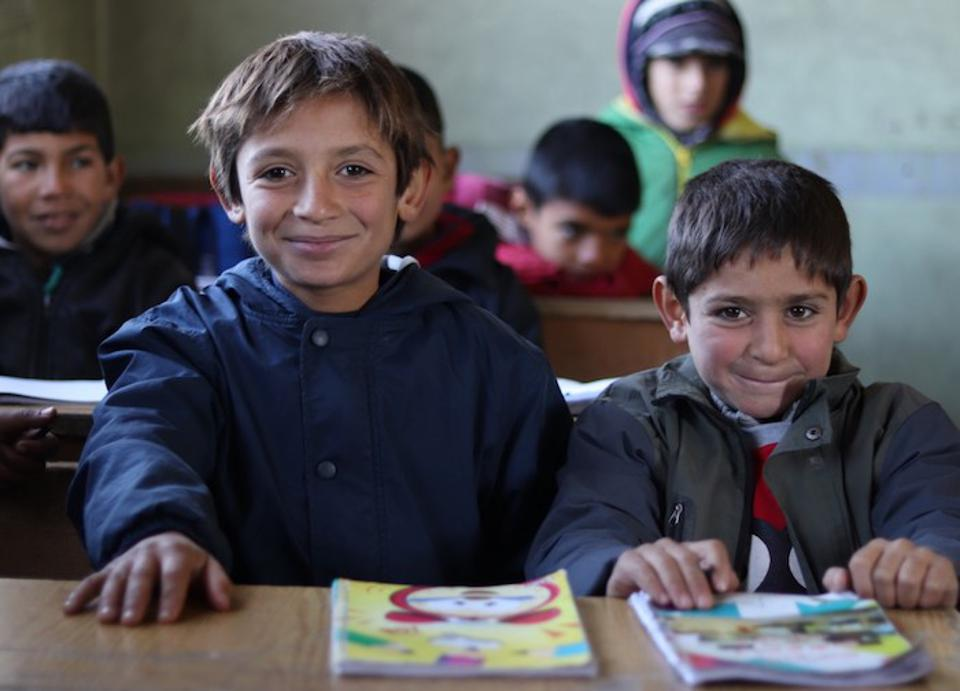 Brothers Omar, 10 (left), and Ali, 7 attend an Educate A Child and UNICEF-supported self-learning session in Qaramel village in northern rural Aleppo, Syria.